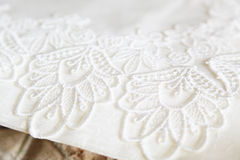 Lace doily. On a photo Embroidered lace doily Stock Images