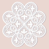 Lace doily. White lace doily with flowery pattern on a beige background Stock Photos