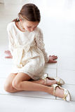 Lace dress. Fashion 7 years old model dressed in ivory lace dress pastel tone stock image
