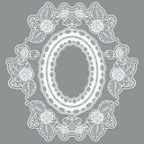 Lace empty flower frame in the shape of the medallion. White lacy cloth on a gray background. Royalty Free Stock Photo