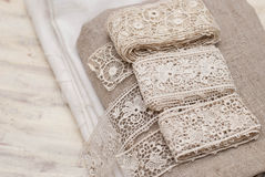 Lace and fabric. Antique handmade lace and fabric stock images