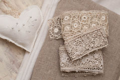 Lace and fabric. Antique handmade lace, fabric and pin cuscion Stock Photos