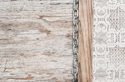 Lace fabric with chain on the old wood Stock Photo