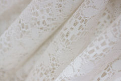 Lace fabric. Close up of white lace fabric folds Stock Image