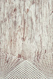 Lace fabric on the old wood Royalty Free Stock Image