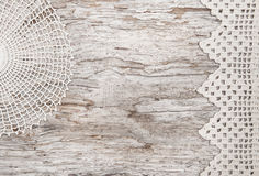 Lace fabric on the old wood Stock Images