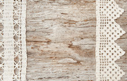 Lace fabric on the old wood Royalty Free Stock Photo