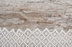 Lace fabric on the old wood Royalty Free Stock Photography
