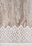Lace fabric on the old wood Royalty Free Stock Photos