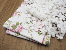 Lace , fabric roses pattern on laminate floor wood pattern Stock Photo