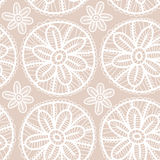 Lace fabric seamless pattern with white flowers on beige background Stock Photos
