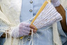 Lace and Fan - Horizontal. Woman in period clothes holding fan and wearing lacy gloves royalty free stock photography