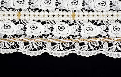 Lace with flowers  and beads Royalty Free Stock Photos
