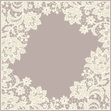 Lace frame. Doily. Floral pattern. Beige Background Stock Image