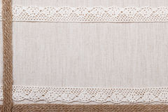 Lace frame on linen cloth background Stock Image