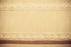 Lace frame on linen cloth background Royalty Free Stock Image