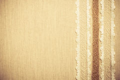 Lace frame on linen cloth background Stock Images