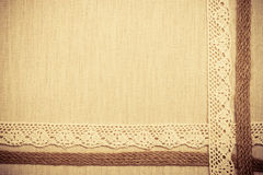 Lace frame on linen cloth background Stock Photo