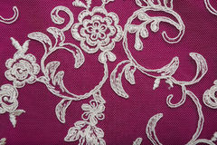 Lace of guipure fabric with white embroidery. Stock Photos