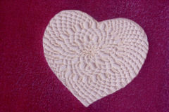 Lace heart. A white lace heart against a mauve background Royalty Free Stock Photo