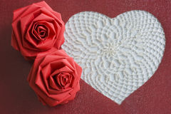 Lace heart. A lace heart and two red paper flowers Royalty Free Stock Photos