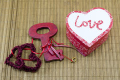 Lace hearts, heart shaped box and a key Stock Photos