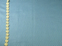 Lace line on blue polka dot background Royalty Free Stock Image