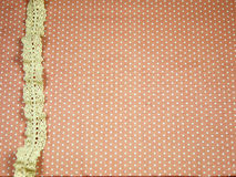 Lace line on orange polka dot background Royalty Free Stock Photography