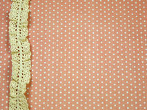 Lace line on orange polka dot background Royalty Free Stock Photos
