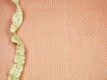 Lace line on orange polka dot background Stock Photography
