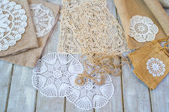 Lace and linen decoration elements. Lace and linen home decoration elements, top view Royalty Free Stock Photography