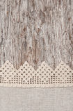 Lace and linen fabric on the old wood Stock Images
