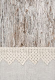 Lace and linen fabric on the old wood Stock Image