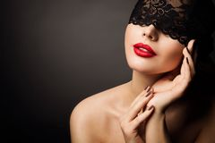 Lace Mask and Red Lips, Beautiful Woman Fantasy, Black Bandage Hide Young Model Face. Over black background stock photos