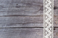 Lace on old wood background Stock Photo