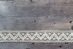 Lace on old wood background Royalty Free Stock Photo