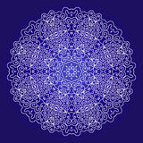 Lace ornament on a blue background Stock Images