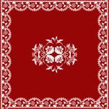 Lace ornament. Red background with white lace ornament Stock Photography