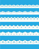 Lace ornaments set. On blue Stock Images