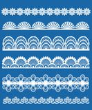 Lace ornaments set. White on blue Royalty Free Stock Image