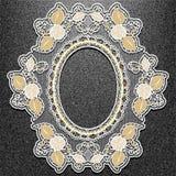 Lace oval frame on black denim background. Royalty Free Stock Photography