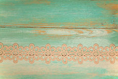 Lace on painted wooden background Royalty Free Stock Photography