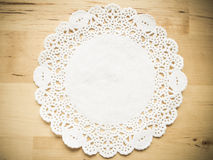 Lace paper on wooden table Stock Image