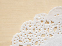 Lace paper on wooden table Royalty Free Stock Image