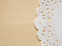 Lace paper on wooden table Stock Photography