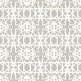 Lace pattern with white shapes in art deco style. Simple elegant lace pattern with white shapes on grey silver background in art deco style. Texture for web Royalty Free Stock Images