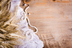 Lace, pearl necklace, earrings and ears of corn, rustic Stock Images