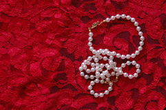 Lace and Pearls. Jewels and red lace, what could be sexier Royalty Free Stock Photos
