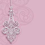 Lace pendant on ornamental pink background. Elegant lace pendant on ornamental pink background, lacy feather decoration, greeting card, wedding invitation or Stock Photo