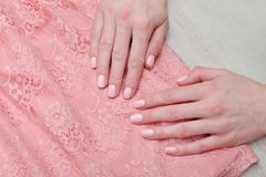 Lace pink  blouse and female hands. Pink manicure. Lace pink blouse and female hands. Pink manicure Royalty Free Stock Photography